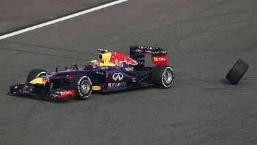 Out of the race: Mark Webber loses his rear wheel.