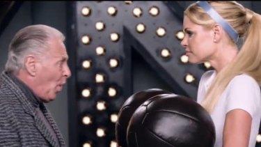 Subtle art ... Sophie Monk returns cleaned balls to an older man.
