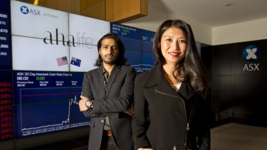 AHA Life founders Shauna Mei (right) and Sachin Devand (left) at listing ceremony for float of their company at the ASX.