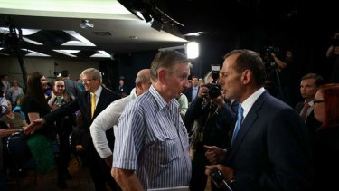 Prime Minister Kevin Rudd and Opposition Leader Tony Abbott meet participants after they attended the People's Forum at the Broncos Leagues Club in Brisbane.