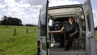 Ric Richardson in his mobile office in Northern NSW.