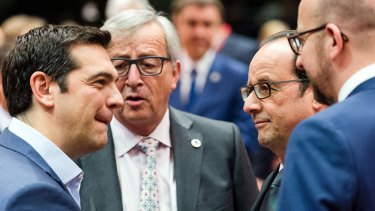 Greek Prime Minister Alexis Tsipras, far left, speaks with (from left) European Commission President Jean-Claude Juncker, French President Francois Hollande and Belgian Prime Minister Charles Michel.