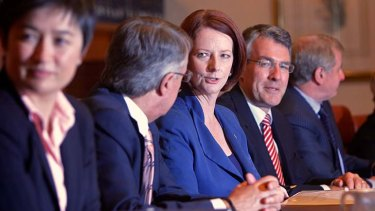 Prime Minister Julia Gillard during a cabinet meeting yesterday.