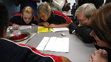 Back to basics ... Kevin Rudd and Julia Gillard observe a science experiment at Amaroo School in Canberra on Monday.