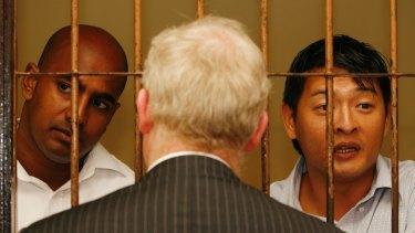 Andrew Chan (right) and Myuran Sukumaran talk with their Australian barrister, Julian McMahon, in 2010.