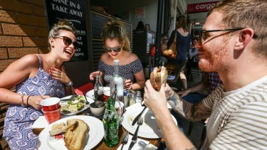 Hannah Campbell, Stephanie Hyde and  David Wood enjoy a recovery breakfast at Coogee Cafe after a big night out.
