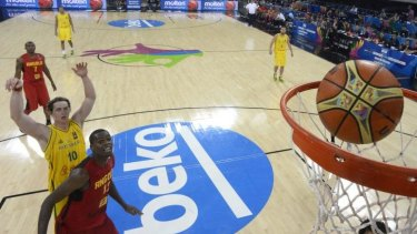 Australian forward Cameron Bairstow scores during the Boomers' shock loss to Angola.