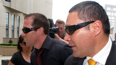 Alleged spammer Lance Atkinson (left) and his lawyer Darrell Kake (right) leave the Federal Court in Brisbane last week.