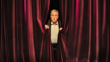 Max Gillies behind the curtain.