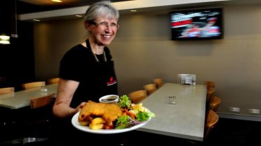 Eastlake bistro manager Janet Craig of Kingston with the chicken schnitzel meal at the club.