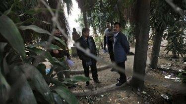 Investigators in New Delhi at the spot of the assault.