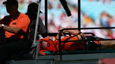 Casualty: Liam Fulton of the Tigers is taken from the field after being injured during against the Dragons.