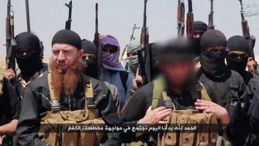 An image allegedly shows members of Islamic State, including Abu Omar al-Shishani (left) and ISIL sheikh Abu Mohammed al-Adnani (right), whose picture was blurred from the source to protect his identity, at an unknown location in Iraq or Syria.
