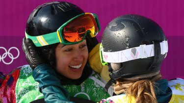 Grateful: Torah Bright congratulates Belle Brockhoff after the two collided in their boardercross quarter-final.
