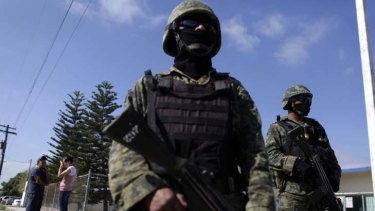 Black hole for Mexican organised crime ... soldiers patrol a neighbourhood in San Fernando, Tamaulipas.