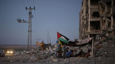 Palestinians in a tent outside apartments in the town of Beit Lahiya in the northern Gaza strip.