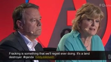 Labor's agriculture spokesperson Joel Fitzgibbon listens to Robyn Clubb, Treasurer of the Royal Agricultural Society of NSW, as she explains her fruit farm is threatened by plans for a mine six kilometres from her property.