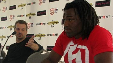 Promoter Tom Huggins and fighter Thierry Sokoudjou.