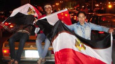 Protesters celebrate Mubarak's resignation in the Egyptian city of Alexandria.