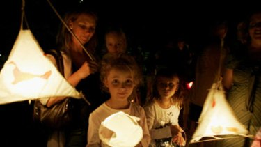 Children celebrate Earth Hour at Avalon Beach, Northern Beaches, Sydney.