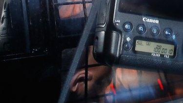 Omarjan Azari under police guard at Sydney's Central Local Court.