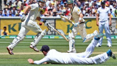 Flat out: Shane Watson and Michael Clarke take a quick run as Ian Bell dives to no avail in the fourth Test at the MCG. It was the ninth Test between the two sides since July.