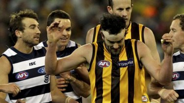 Rivals: Jordan Lewis tangles with the Cats in last year's finals.
