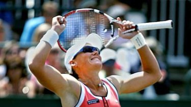 Samantha Stosur celebrates after winning the singles final at the Family Circle Cup Tennis Tournament in Charleston, South Carolina.