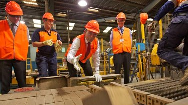 High visibility: As opposition leader in 2011, Tony Abbott warned this Sydney brick manufacturer it would lose $2 million a year through the carbon tax.