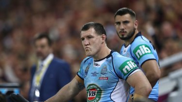 Changing of the guard: Paul Gallen and Jack Bird watch on from the bench during Origin II.