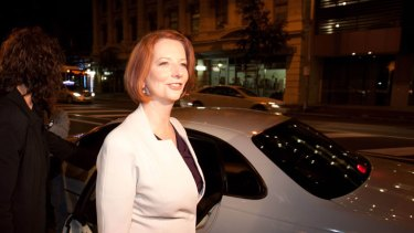 Taking it on the chin  ...   Julia Gillard defended the carbon tax yesterday in Brisbane.