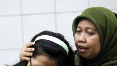 A relative of a passenger of the Sukhoi Superjet 100 aircraft cries at Halim Perdana Kusuma Airport in Jakarta.