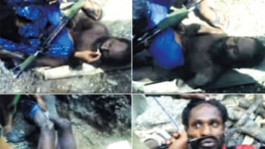 ''Get a fire'' ... video posted on YouTube shows two Papuan men being tortured by apparent members of the Indonesian security services.  One has a smouldering stick applied to his genitals.