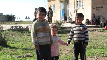 Children on a farm recently freed from Islamic State control.