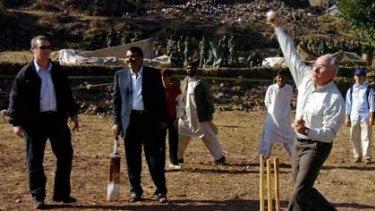 Former Australian PM John Howard rolls his arm over in Kashmir in 2005.