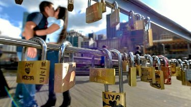 """The tradition of """"love locks"""" has made it from Europe to the Yarra Footbridge at Southgate."""