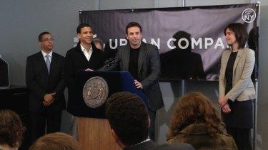 Creating a local network ... Urban Compass co-founder Dr Ori Allon, centre, launches his latest venture in New York.