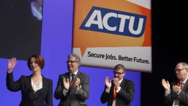 Tale of humility ... Julia Gillard with the newly-elected secretary of the ACTU, Dave Oliver, speaks at the congress in Sydney.