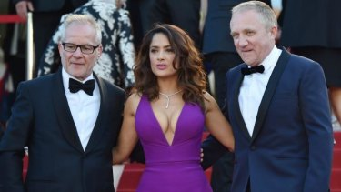 Salma Hayek with the General Delegate of the Cannes Film Festival Thierry Fremaux (left) and her husband Francois-Henri Pinault.