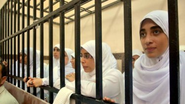 An Egyptian court has handed down heavy sentences of 11 years in prison to 21 female supporters of the ousted Islamist president, many of them juveniles, for holding a protest.