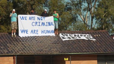 Speaking up ... Protestors from the refugee action coalition at Villawood Detention Centre.