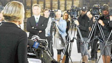 Brave face... Kristina Keneally addresses the media after a resignation.