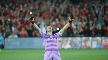 At last... Adelaide United goalkeeper Eugene Galekovic celebrates his side's grand final triumph.
