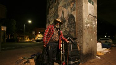 Nomadic community ... Les Gordon bunks down for the night with other homeless people under the train line in Woolloomooloo.
