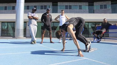 Asafa Powell in Melbourne during the week checking out the form of young Australian sprinter Jarrod Geddes.