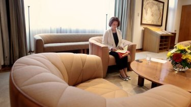 Prime Minister Julia Gillard sorts through her paperwork in her office at Parliament House.