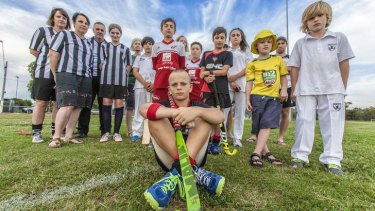 Domenic Oswald, 11 (centre) with members of some of the sports clubs that use Ormond Park, Moonee Ponds.