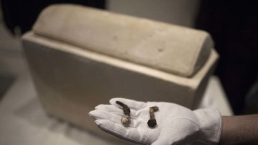 Two Roman nails next to a Roman period ossuary which Simcha Jacobovici   believes may have been used in the crucifixion of Jesus.