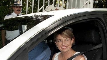 Anna Bligh leaves government house after officially calling an election in Queensland for March 24.