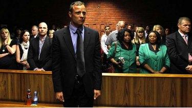 Dark days ... Oscar Pistorius awaits the start of court proceedings in the Pretoria Magistrates court.